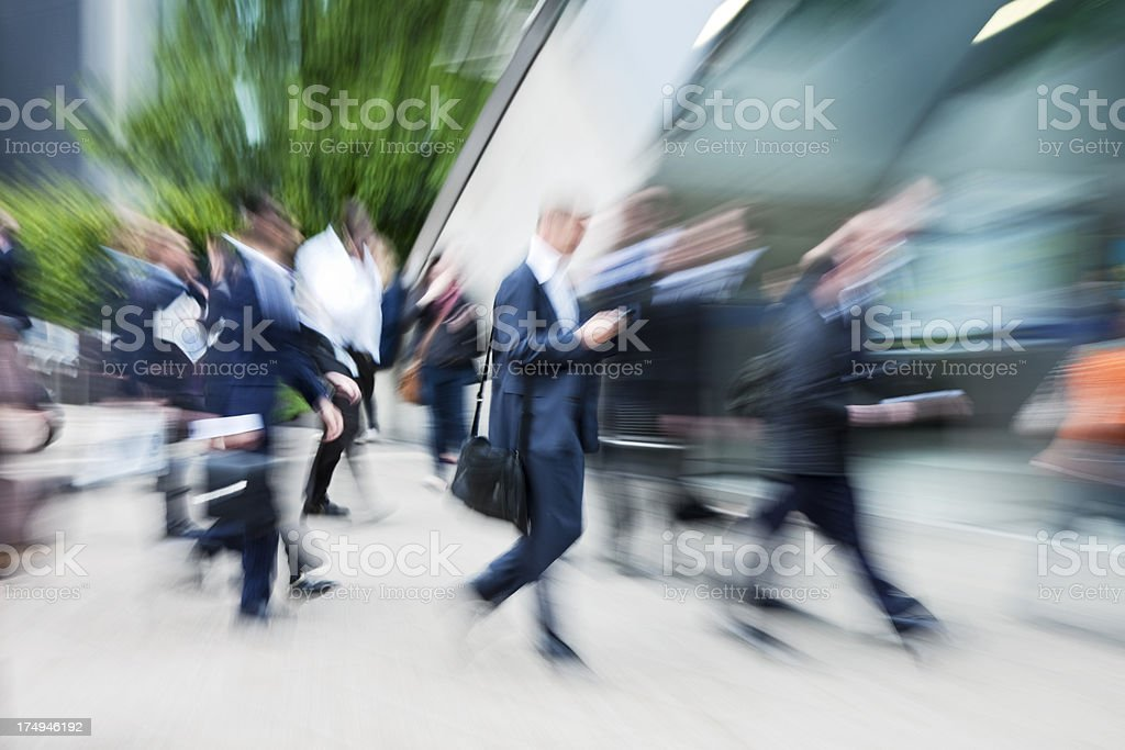 Business Commuters Walking in Financial District, Blurred Motion, London, UK royalty-free stock photo