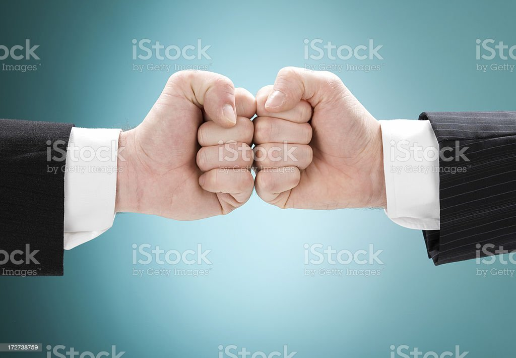 business competition concept with fist isolated royalty-free stock photo