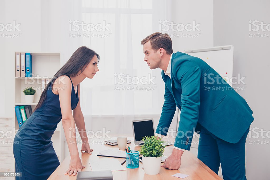 Business competition. Two colleagues having disagreement and conflict stock photo