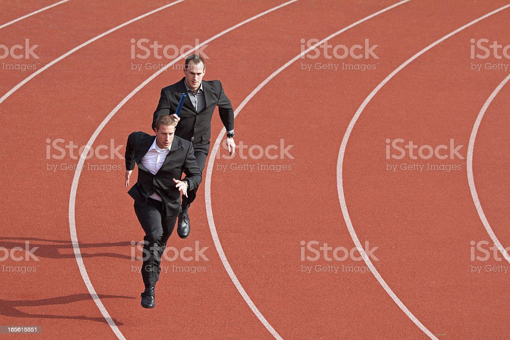 business competitors on sports track stock photo