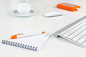 Business Composition on white Desk orange Items