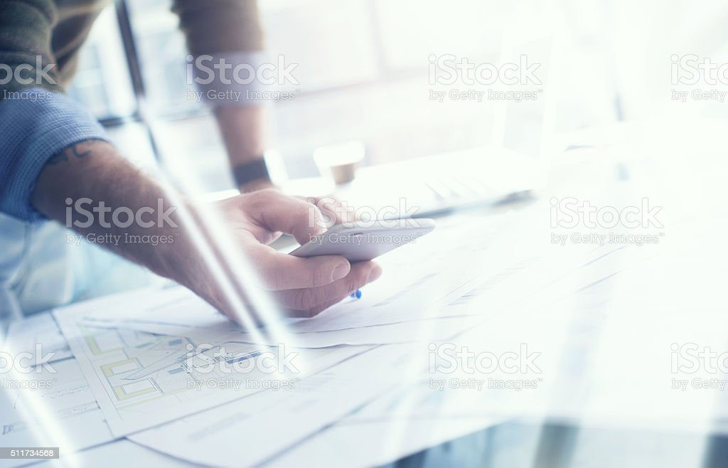 Business concept, businessman making photo smartphone. Architectural project on the stock photo