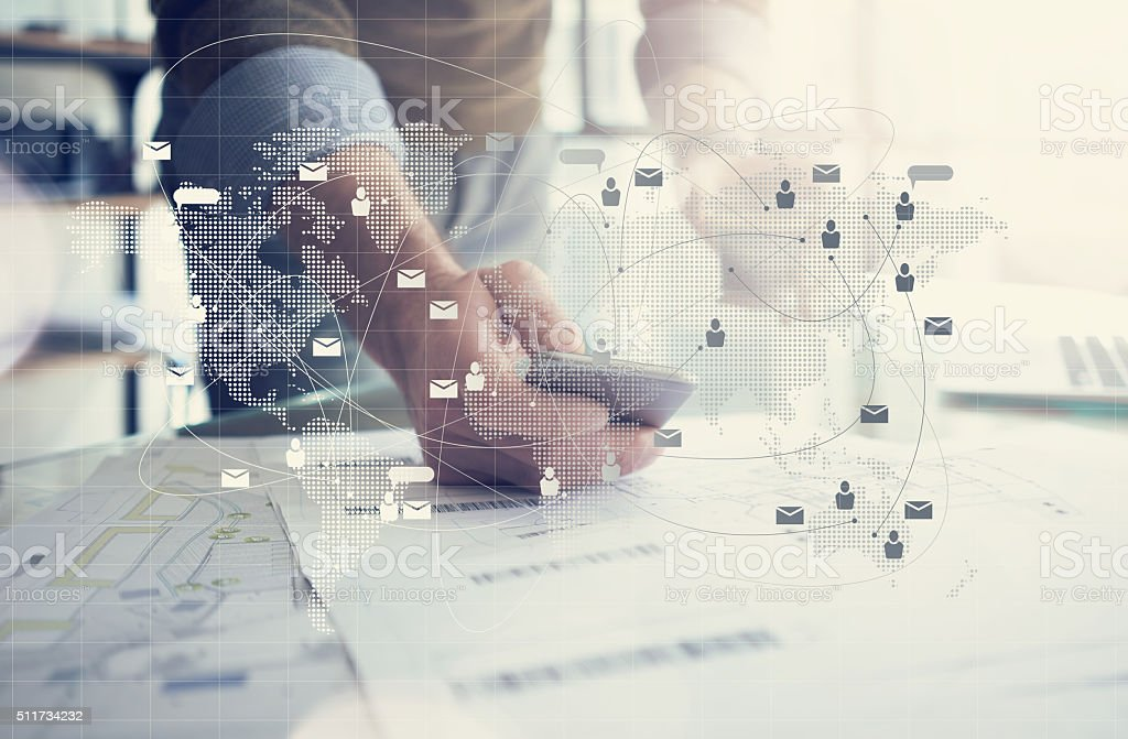 Business concept, businessman working with smartphone. Architectural plans on the stock photo