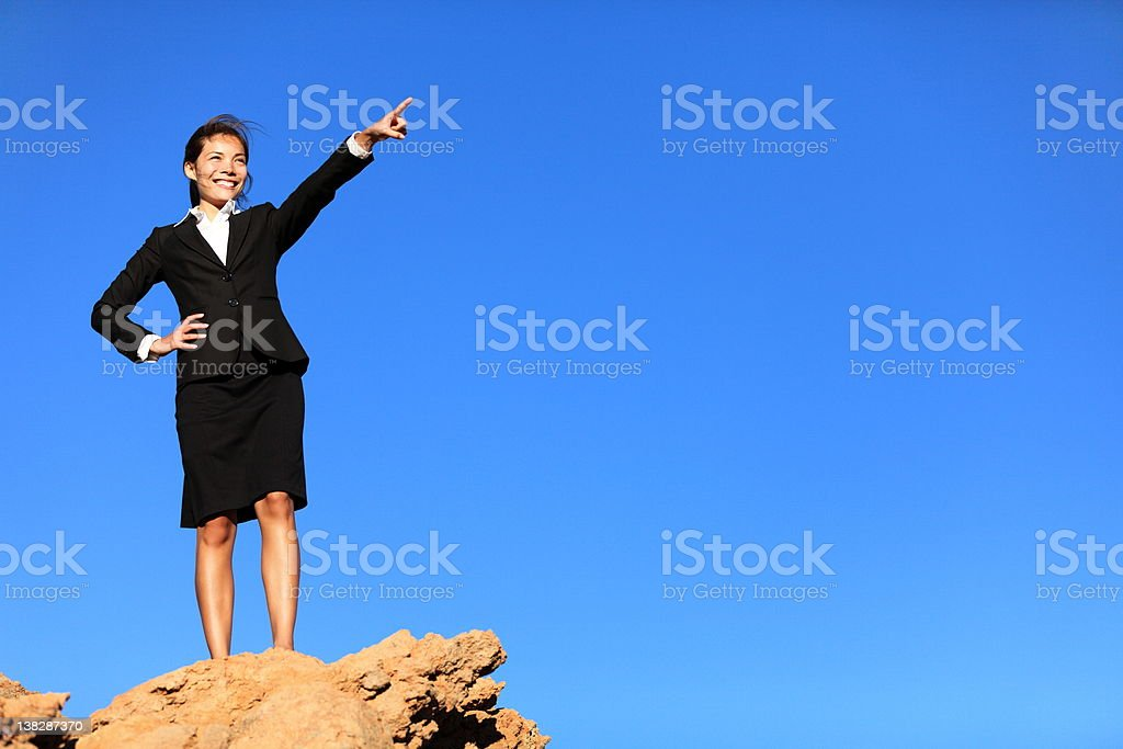 Business concept - businesswoman pointing at future ahead stock photo