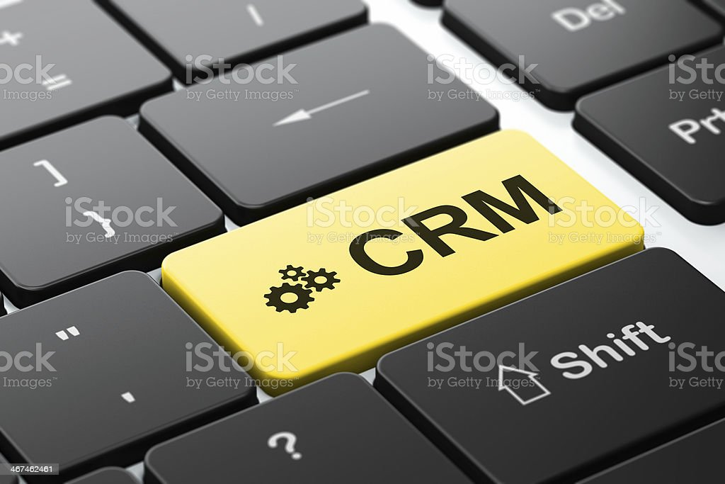 Business concept: Gears and CRM on computer keyboard background royalty-free stock photo