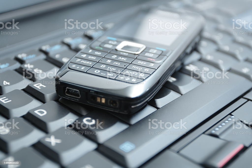 Business concept mobile phone and laptop(clean!) royalty-free stock photo