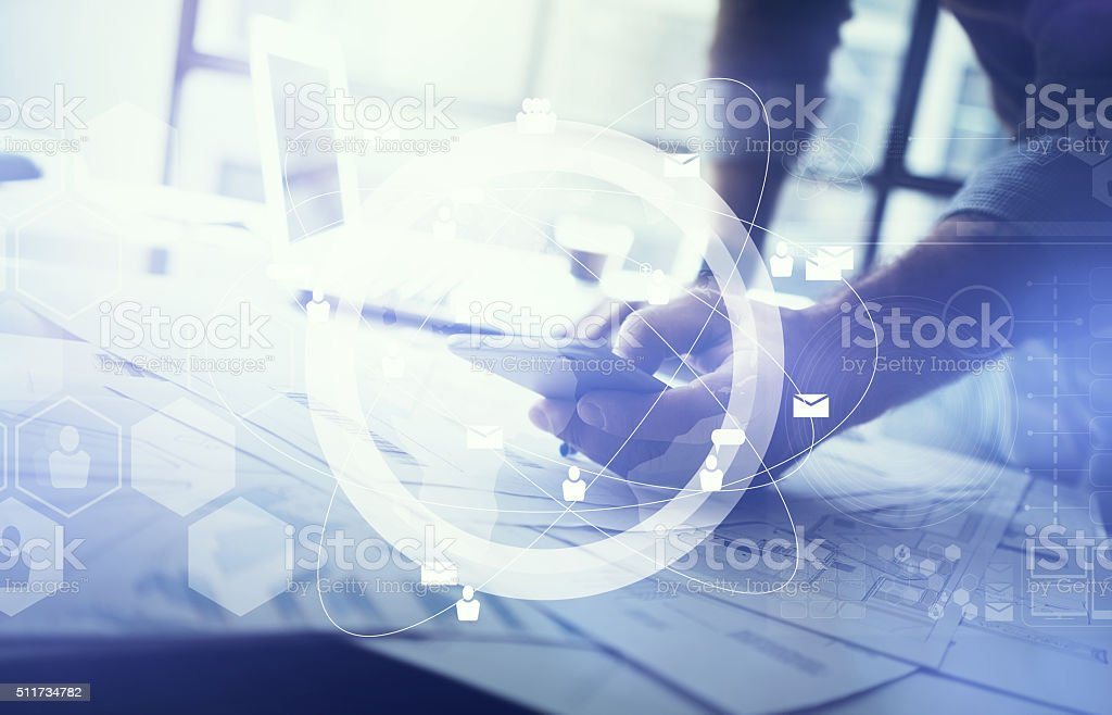 Business concept of businessman using smartphone. Architectural project on the stock photo