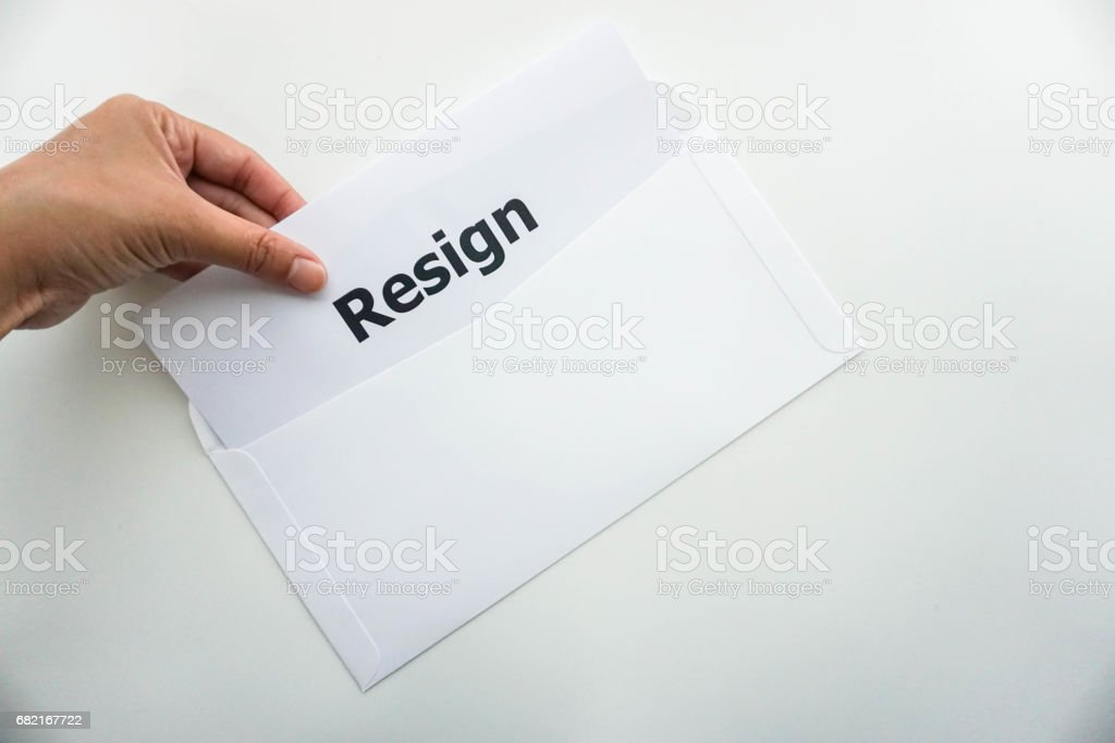 business concept of isolated woman hold resignation letter in left hand stock photo