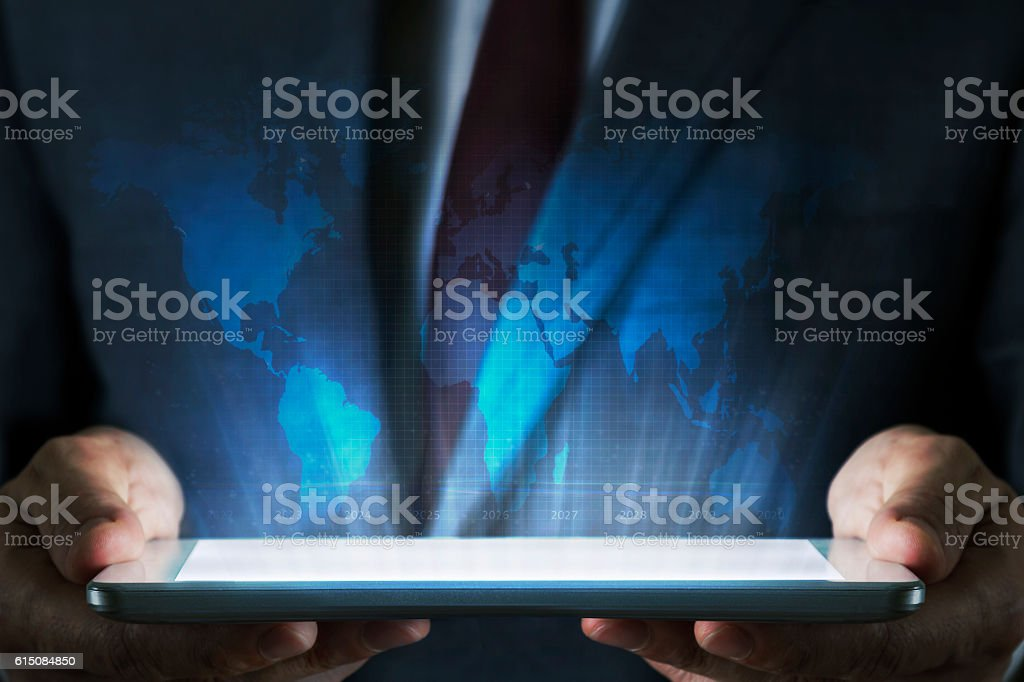 Business concept on tablet with hologram stock photo