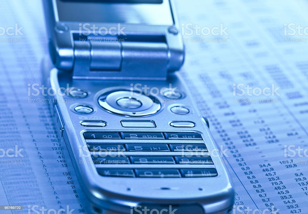 Business Concept Phone and Financial Report royalty-free stock photo