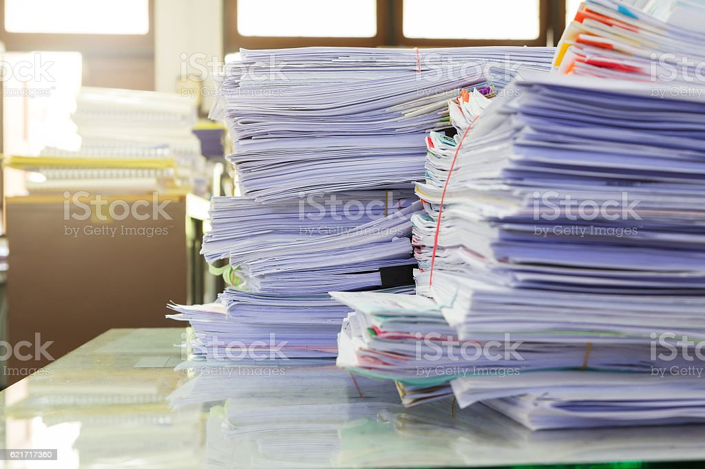 Business Concept, Pile of unfinished business documents on office desk, stock photo