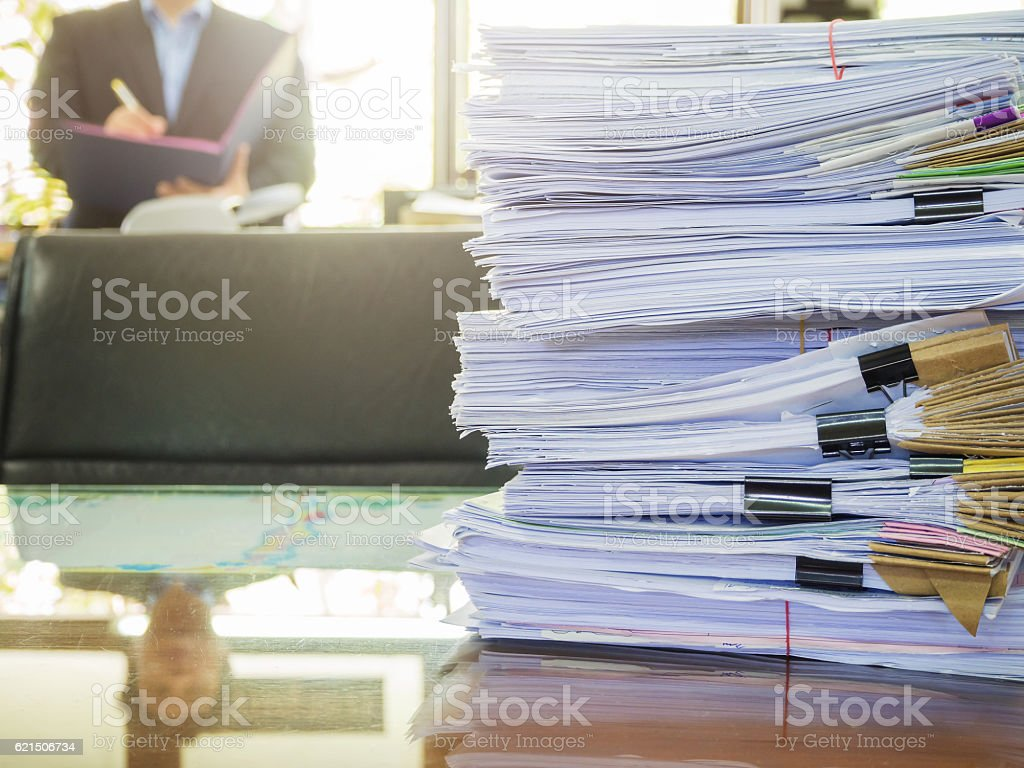 Business Concept, Pile of unfinished documents on office desk, Stack stock photo