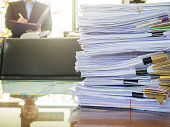 Business Concept, Pile of unfinished documents on office desk, Stack