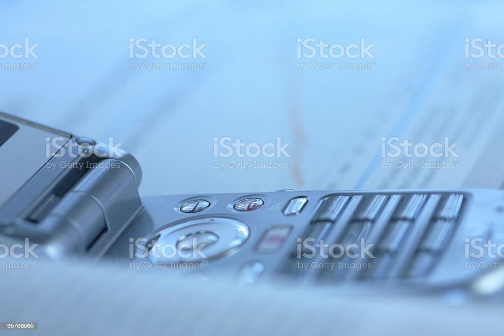 Business Concept With Mobile Phone and Stock Market Charts royalty-free stock photo