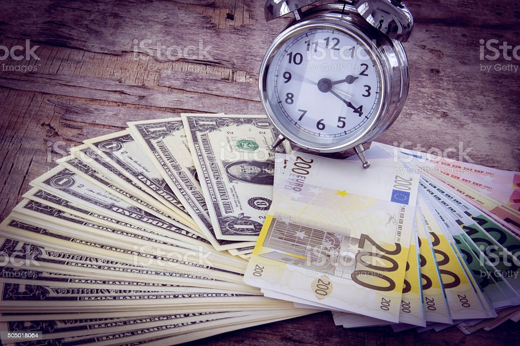 Business concept with money Euro and American Dollar on wooden stock photo
