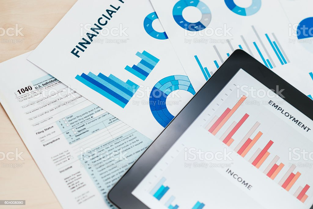 Business concept with stock market charts, business and tax form stock photo