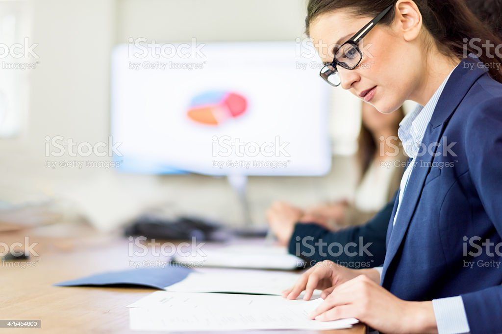 Business Conference Call Woman Analyzing Financial Figures stock photo