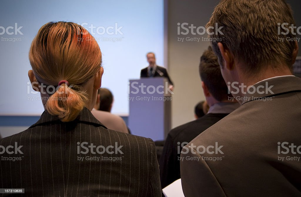 Business conference with lecturer and audience stock photo