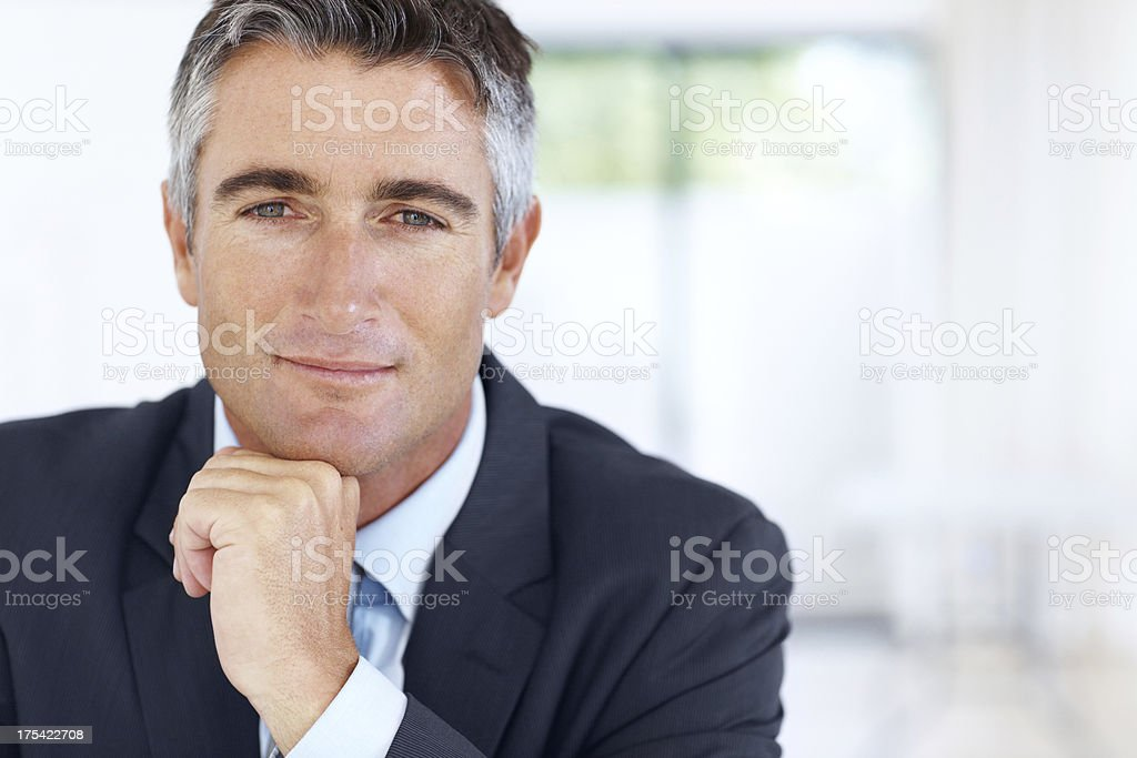 Business consultant looking straight at the camera stock photo