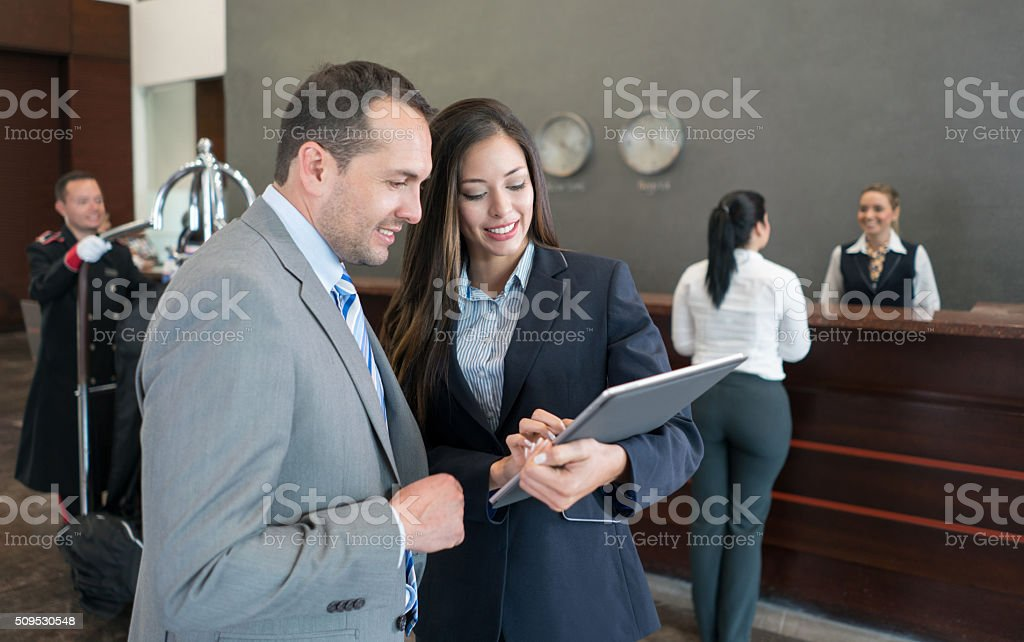 Business couple at a hotel stock photo