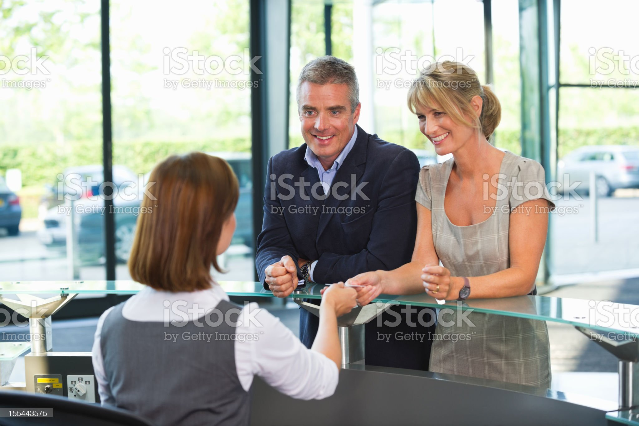Business Couple At Reception Desk royalty-free stock photo