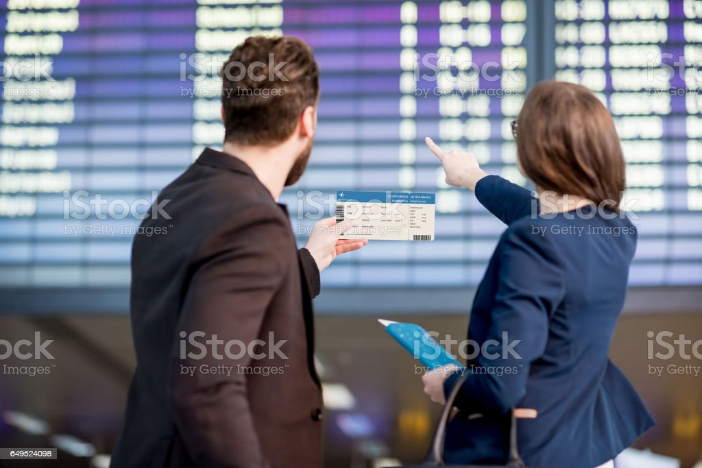 Business couple at the airport stock photo