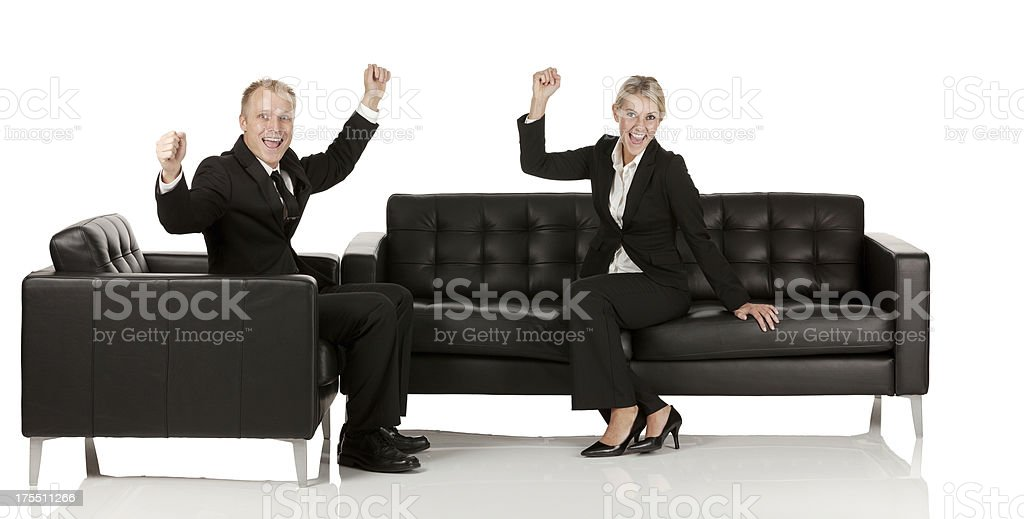 Business couple celebrating their success royalty-free stock photo