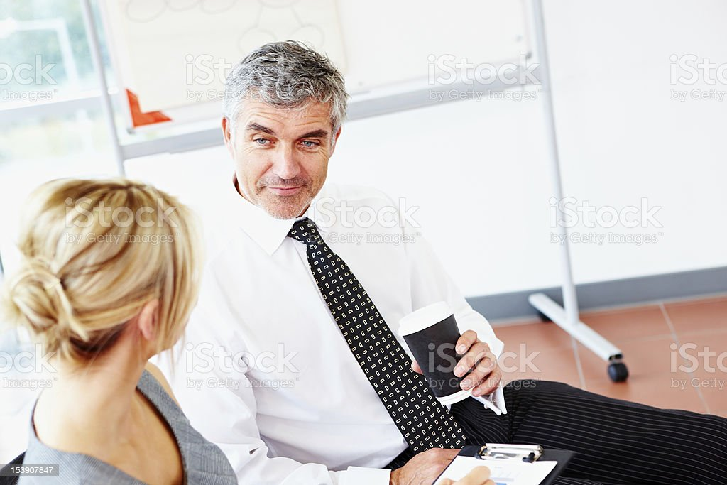 Business couple chatting in meeting royalty-free stock photo