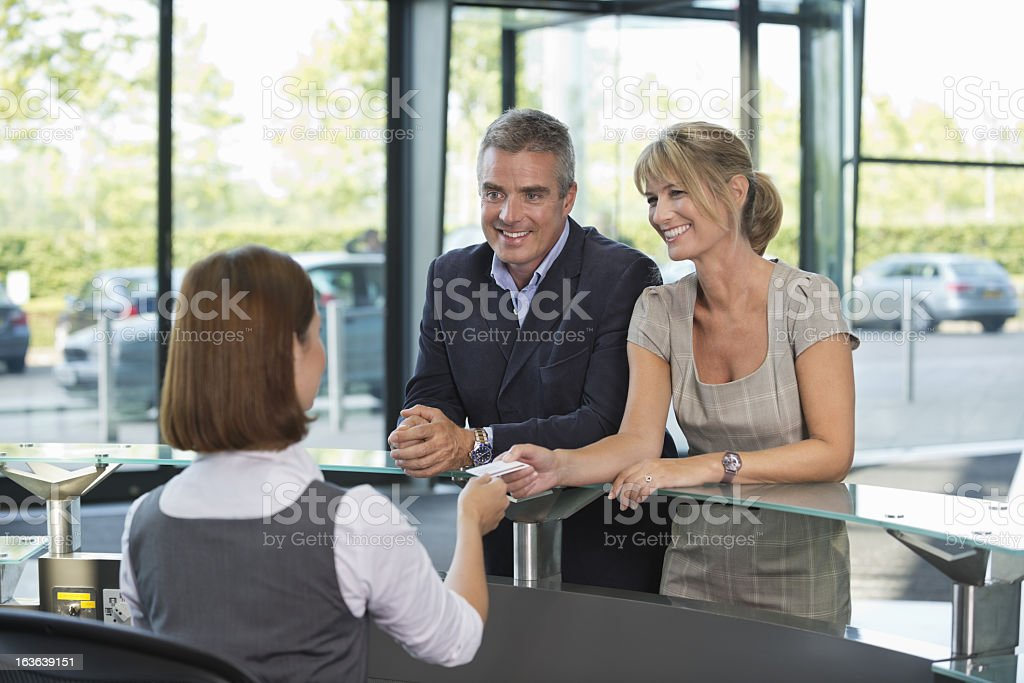 Business Couple Collecting Room Access Card stock photo