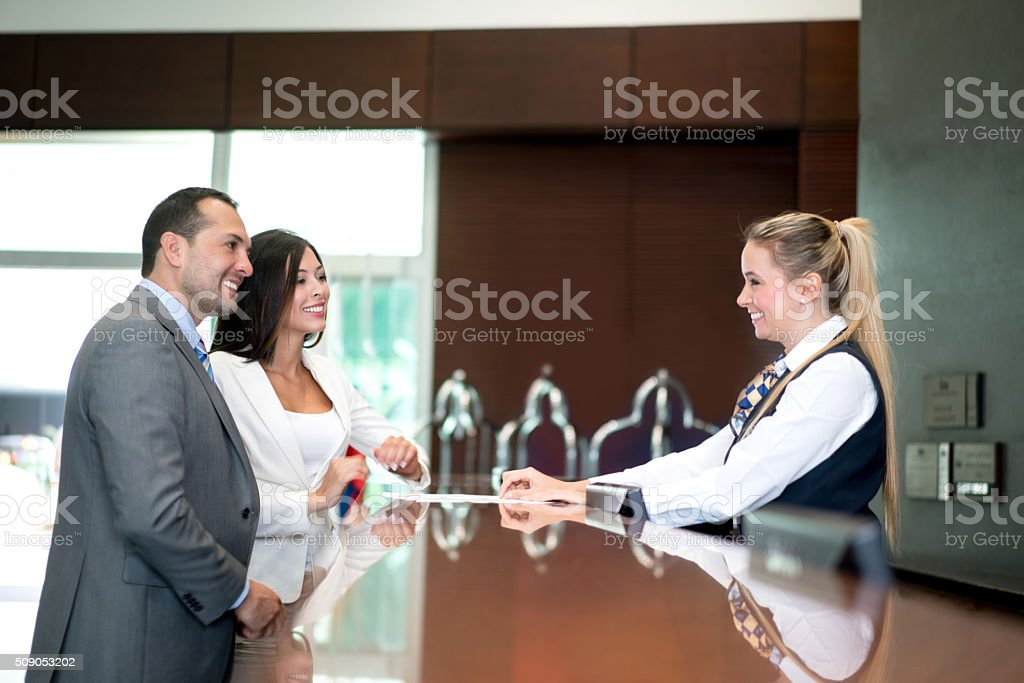Business couple doing check in at the hotel stock photo
