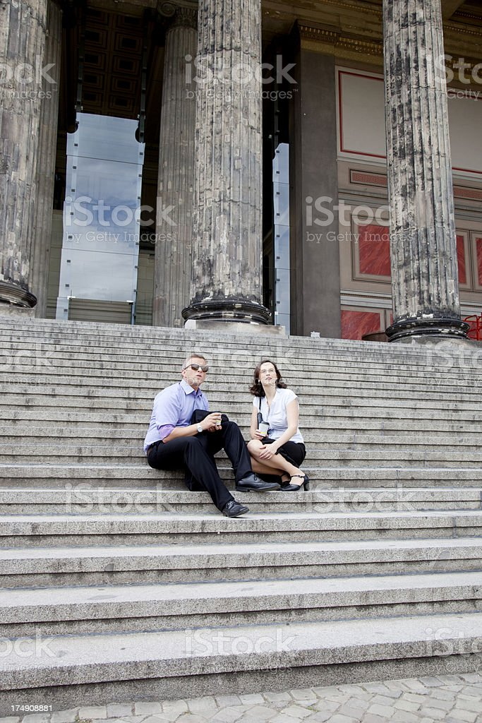 Business couple enjoying the end of work day royalty-free stock photo