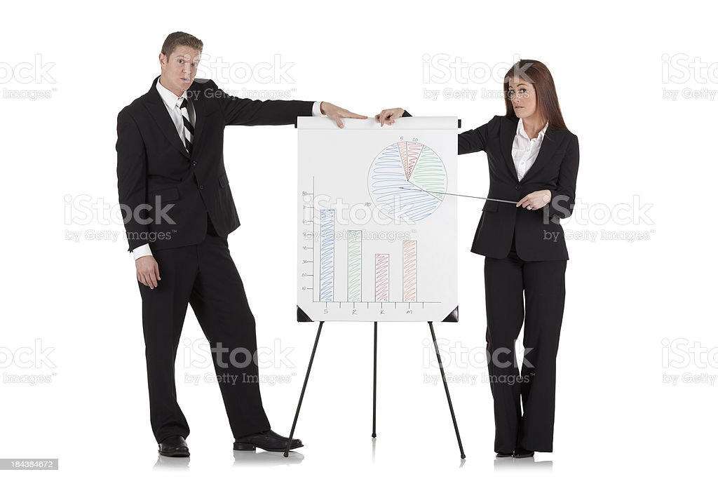 Business couple giving a presentation royalty-free stock photo