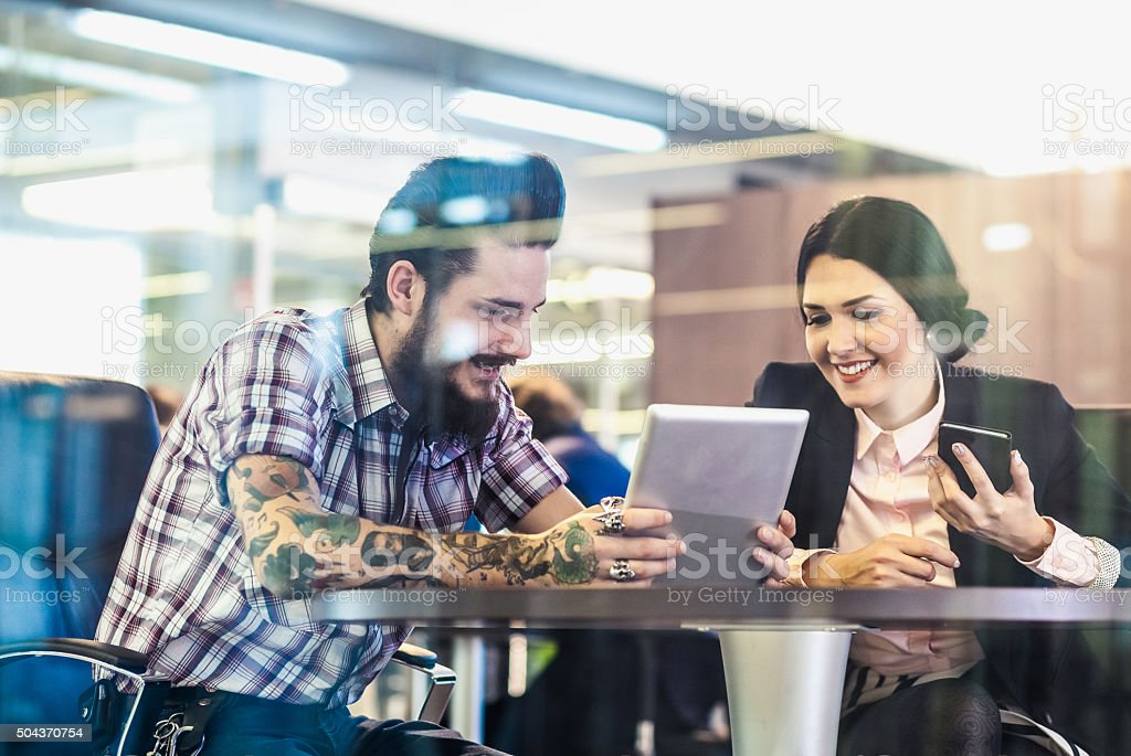 Business couple having a meeting stock photo