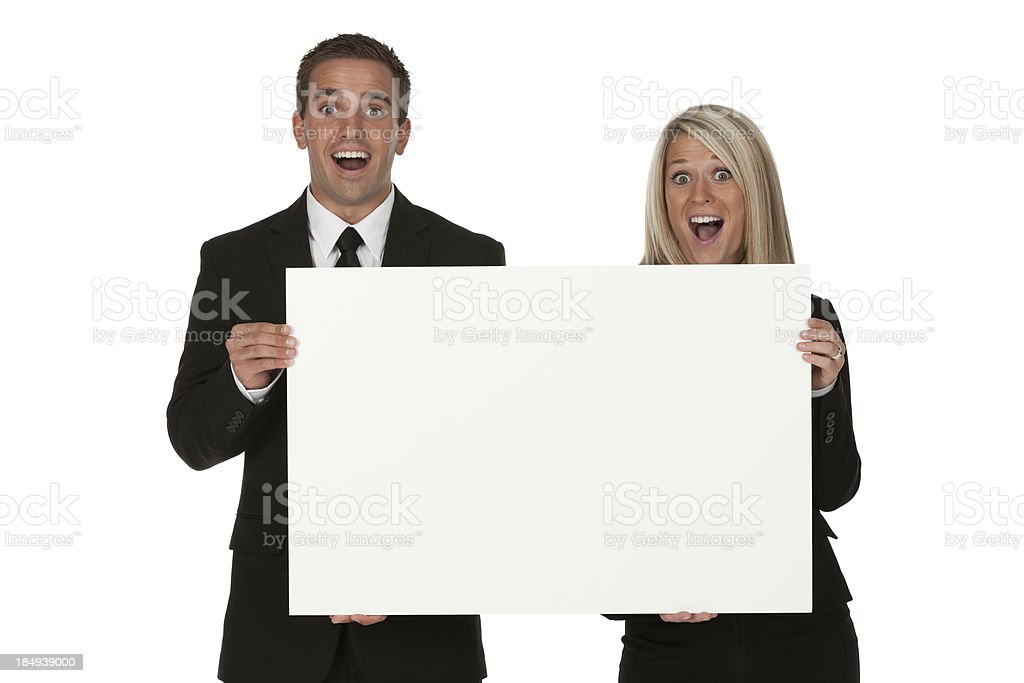 Business couple holding a placard royalty-free stock photo