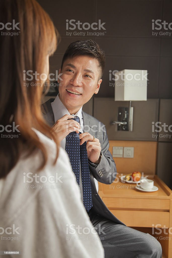Business couple in hotel room royalty-free stock photo