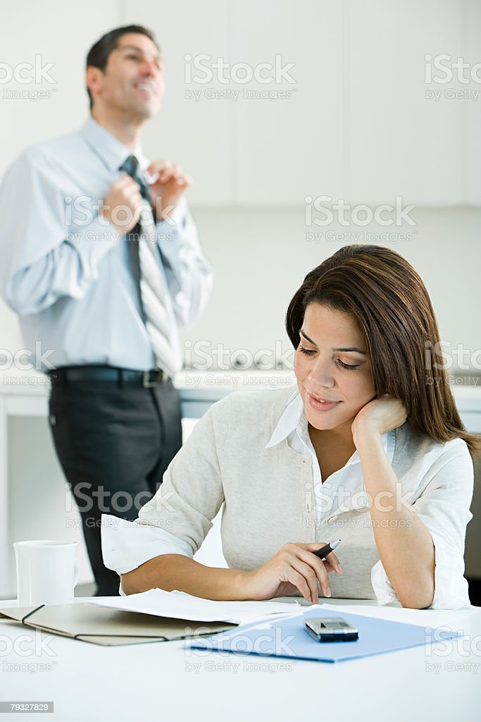 Business couple in kitchen stock photo