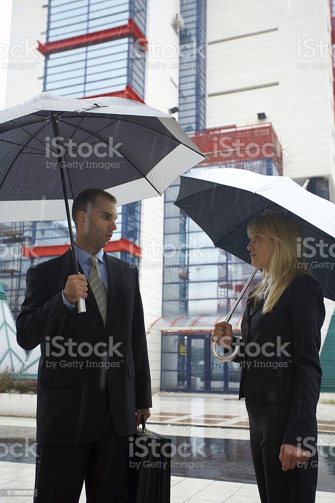 Business Couple in Rain Holding Umbrella royalty-free stock photo