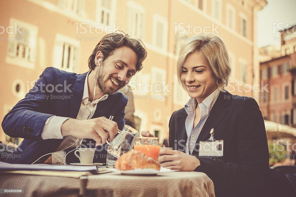 Business couple in Rome having breakfast stock photo