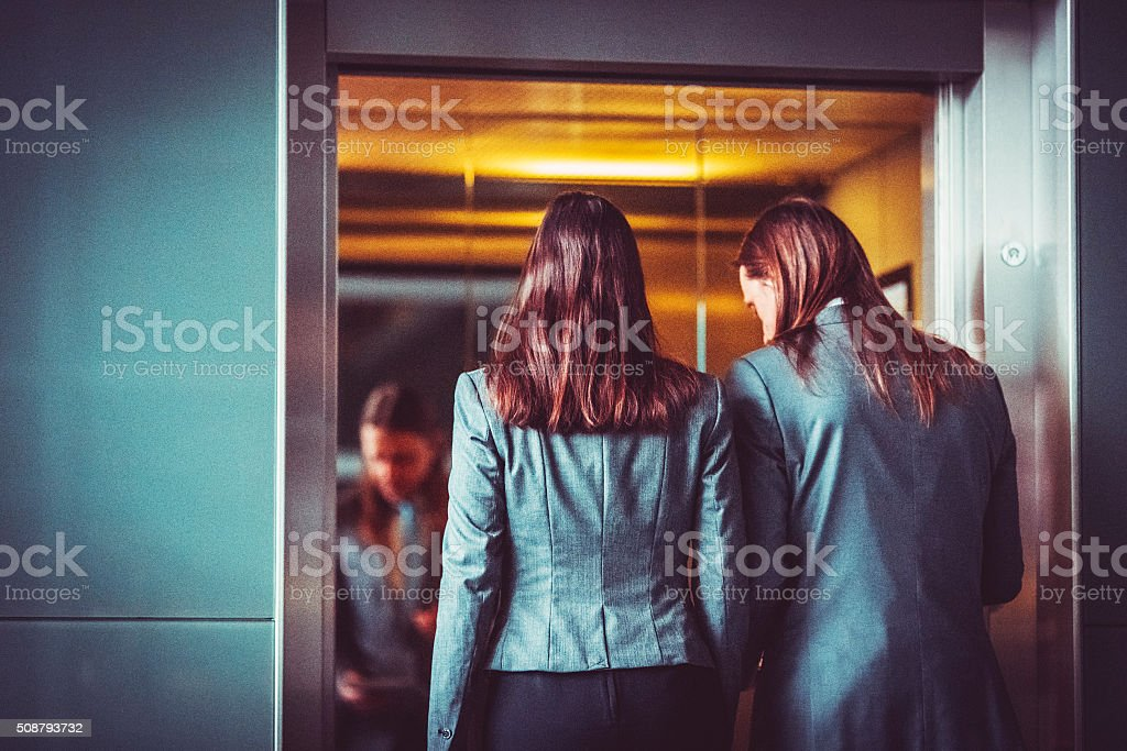 Business couple in the elevator stock photo