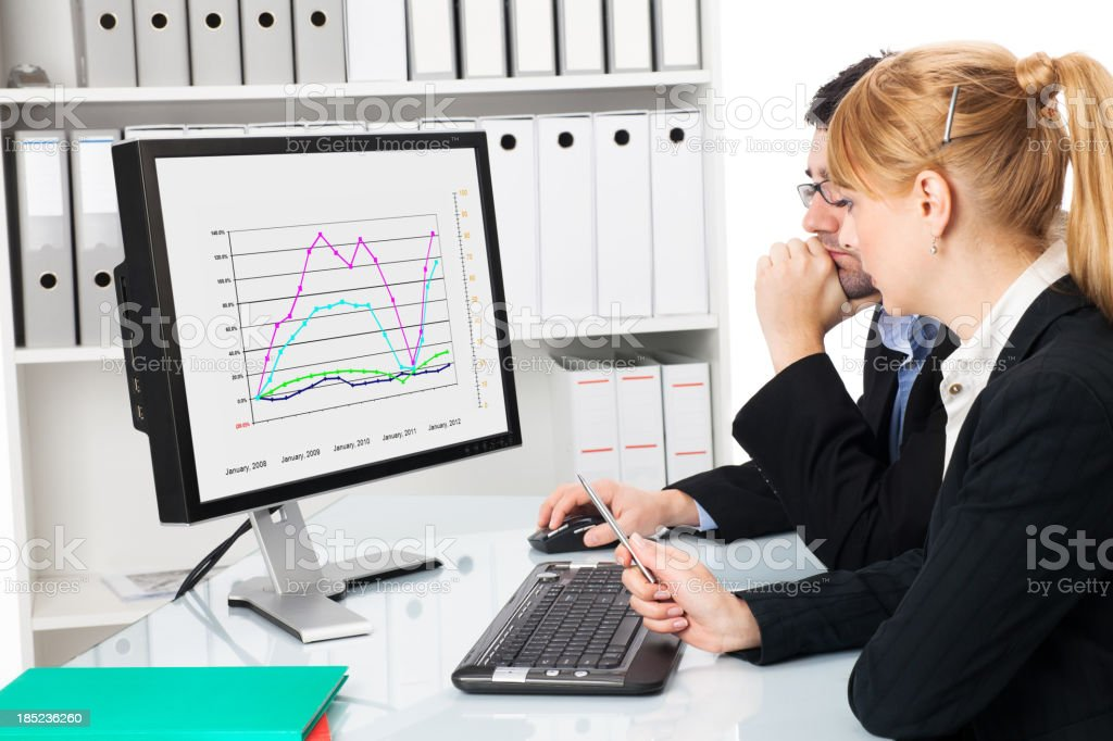 business couple  looking at graph chart royalty-free stock photo
