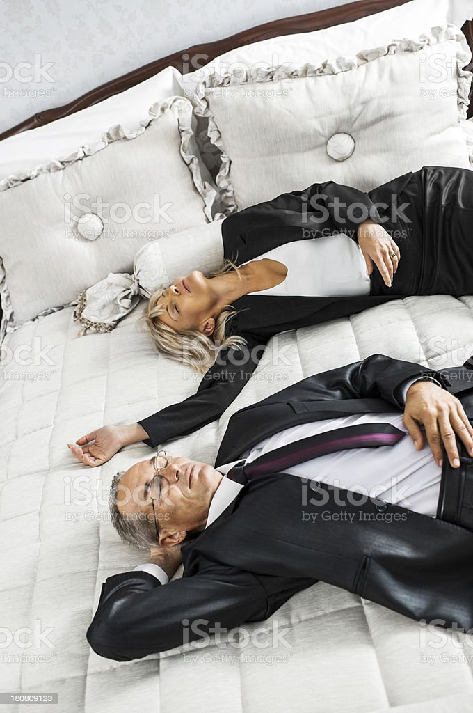 Business couple resting at a hotel room. royalty-free stock photo