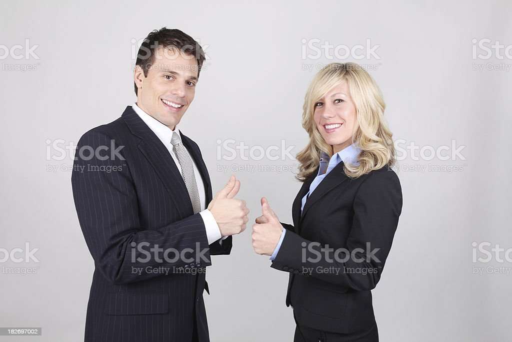 Business couple showing thumbs up royalty-free stock photo