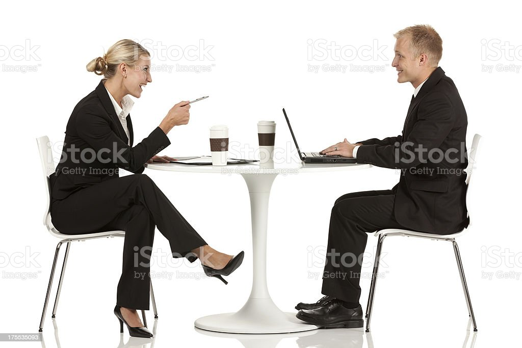 Business couple smiling at each other in a restaurant royalty-free stock photo