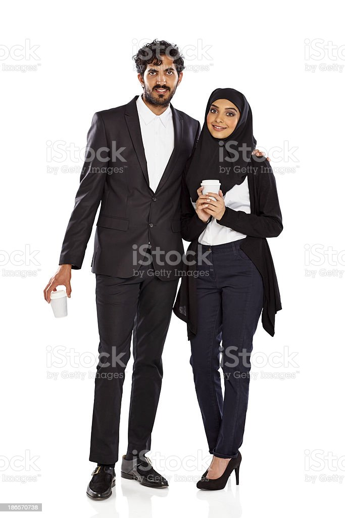 Business couple standing together with a cup of coffee royalty-free stock photo
