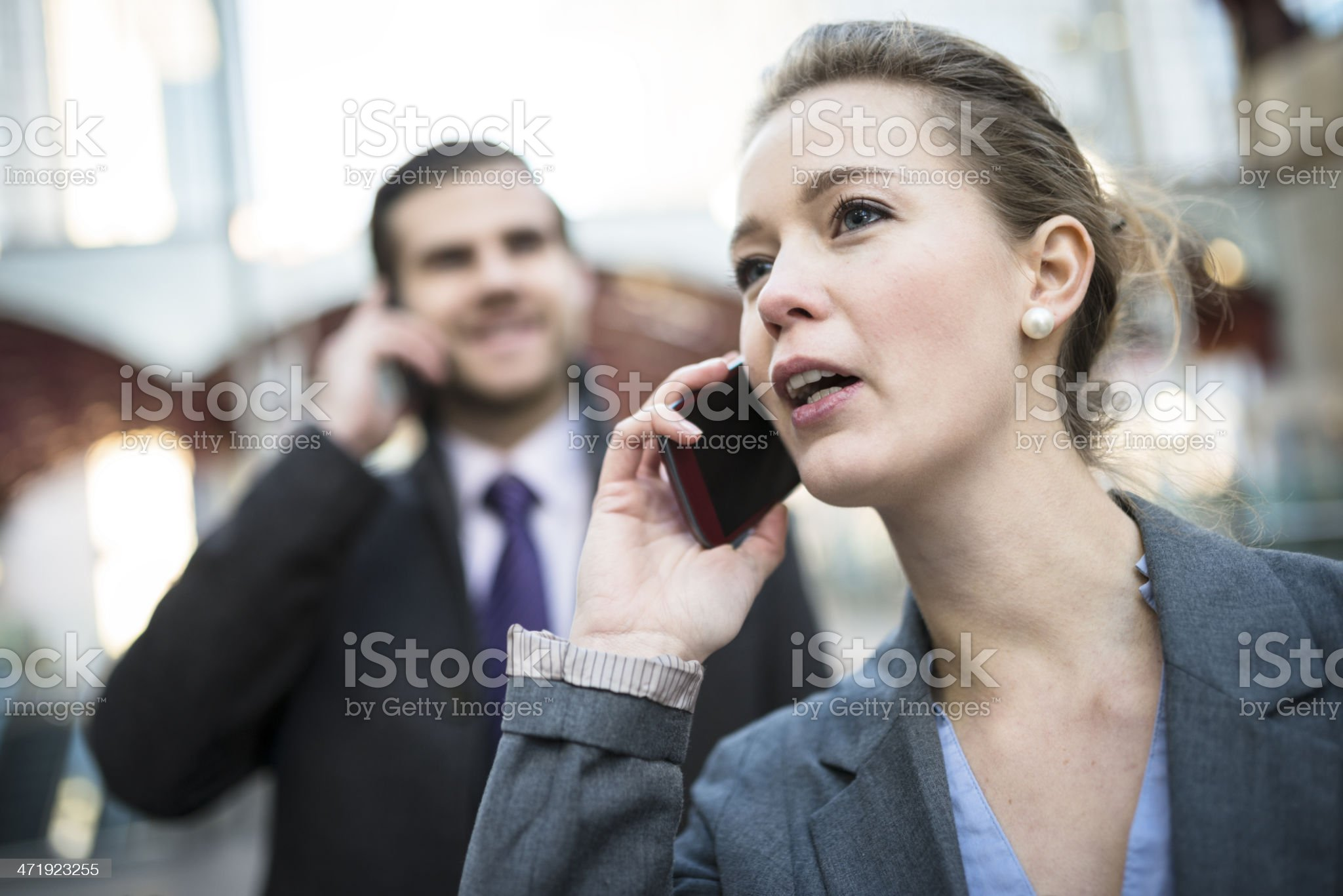 Business couple talking on mobile phone royalty-free stock photo