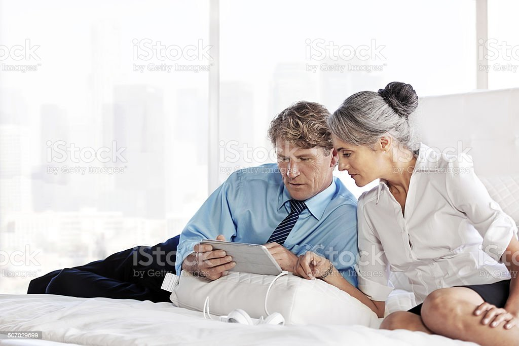 Business couple using a digital tablet stock photo