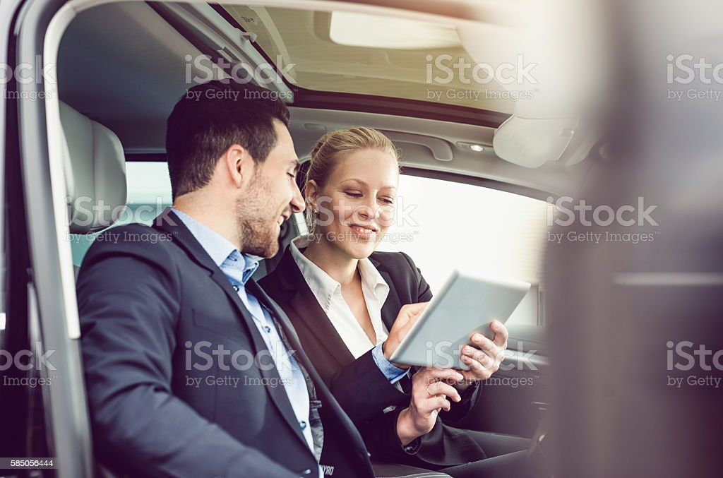Business Couple using a Tablet in the Car stock photo