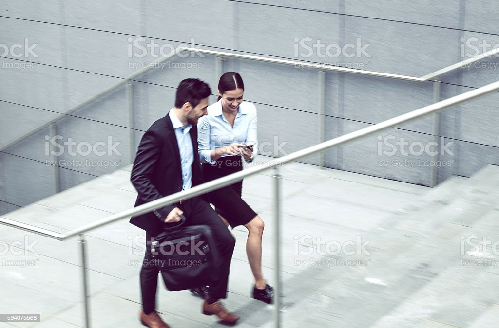 Business Couple Walking up the Stairs stock photo