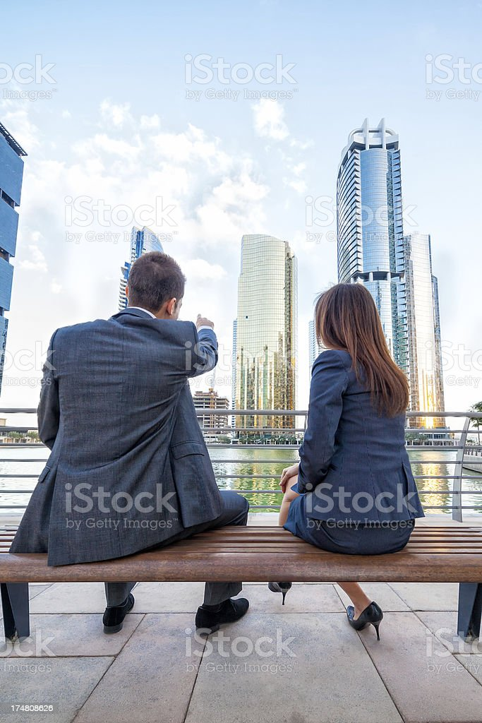 Business couple with modern architecture stock photo