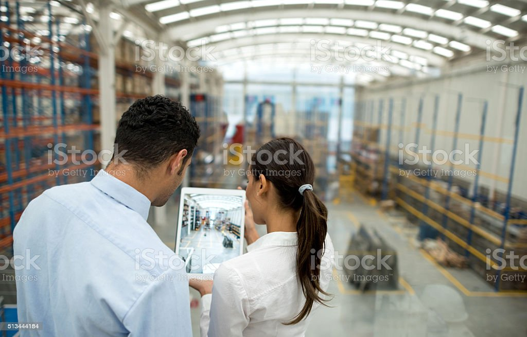 Business couple working on freight transportation stock photo